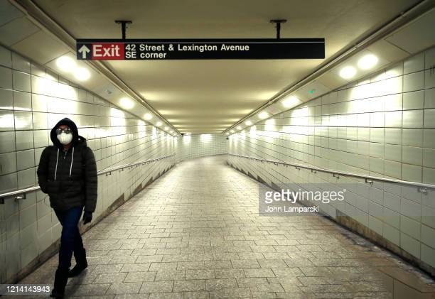 A man walks in a subway tunnel on 42 Street as the city attempts to slow down the coronavirus through social distancing on March 22 2020 in New York...