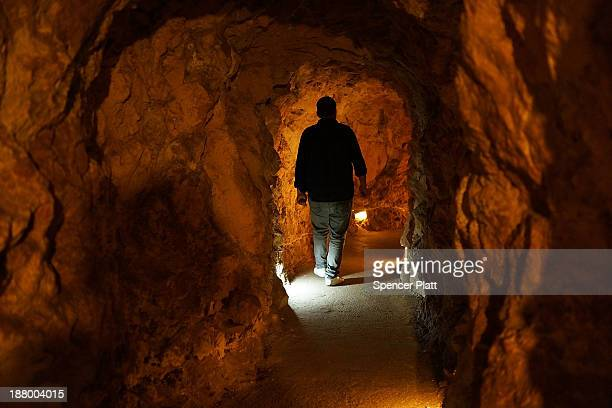 A man walks in a tunnel in a underground bunker at the Resistance Museum a showcase built by the Shi'ite militia group Hezbollah which controls large...