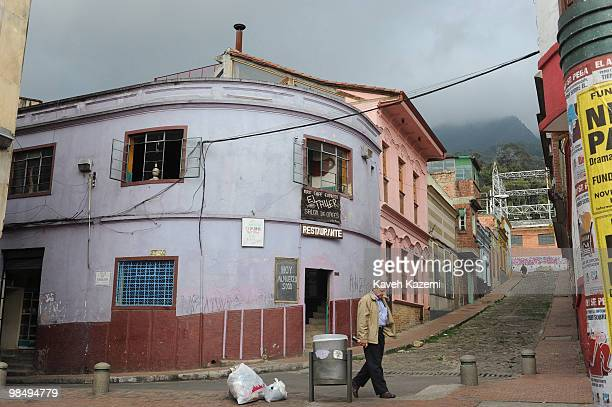 A man walks in a typical neighborhood in Candeleria old part of the city Bogota formerly called Santa Fe de Bogota is the capital city of Colombia as...