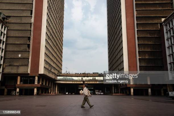 A man walks in empty Caracas Square as a preventive measure against the new type of coronavirus pandemic in Caracas Venezuela on April 02 2020