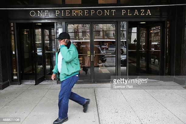 A man walks in front of a building which according to reports is to be the future headquarters for the presidential campaign of Hillary Clinton on...