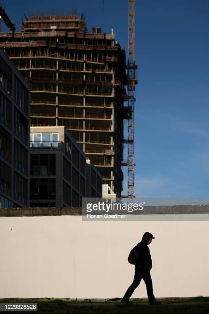 Man walks in front of a construction site on October 28, 2020 in Berlin, Germany.