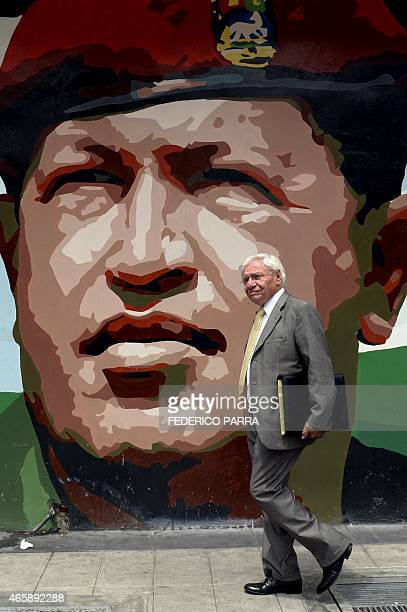 A man walks in front of a mural depicting late Venezuelan President Hugo Chavez in Caracas on March 11 2015 Venezuelan President Nicolas Maduro moved...