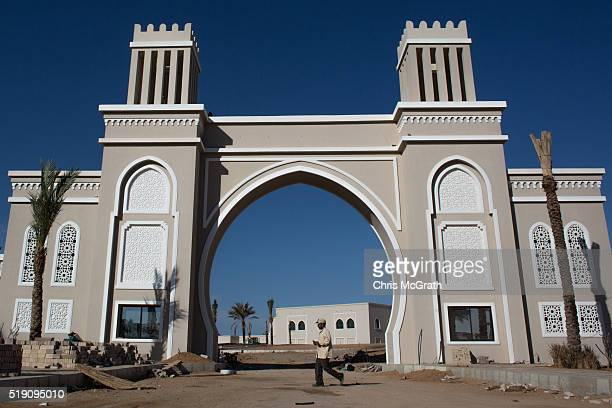 A man walks in front of a new hotel under construction in Nabq district on April 3 2016 in Sharm El Sheikh Egypt Prior to the Arab Spring in 2011...