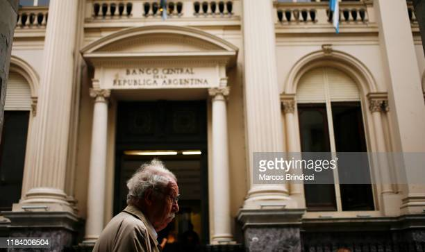 A man walks in front of Argentina's Central Bank on October 28 2019 in Buenos Aires Argentina National Central Bank restricted the limit for dollar...