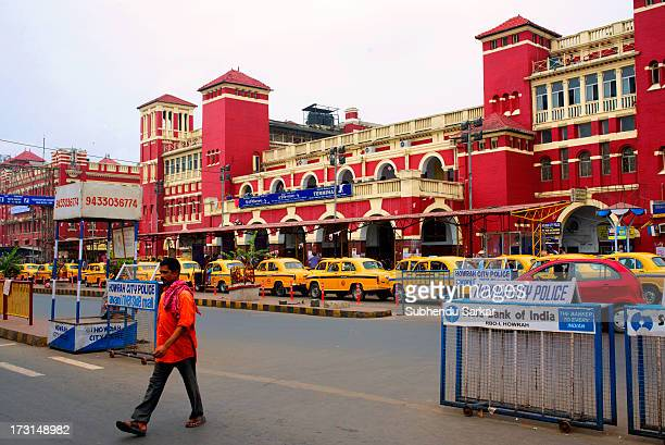 CONTENT] A man walks in front of Howrah Railway Station in West Bengal India