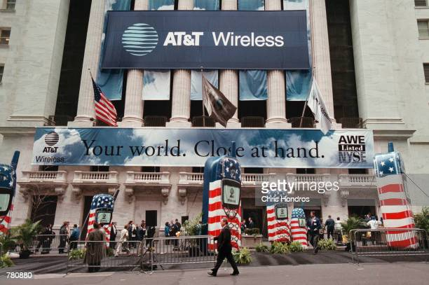 A man walks in front of inflatable phones and signs outside of the New York Stock Exchange in New York City April 27 2000 In the biggest initial...