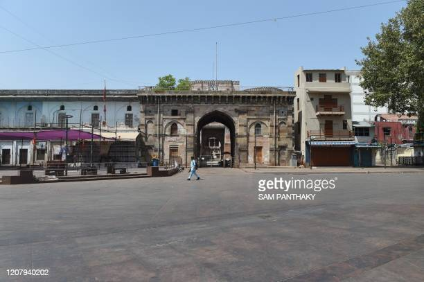 Man walks in front of the ancient Bhadra Fort during a one-day nationwide Janata curfew imposed as a preventive measure against the COVID-19...