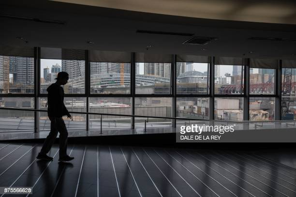 A man walks in front of the construction site of the West Kowloon station of the highspeed rail link which will connect the city to the southern...