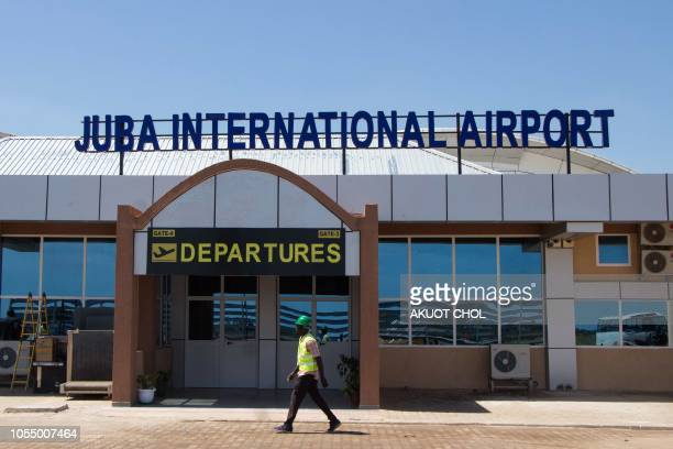 A man walks in front of the departure gate of the new terminal building at Juba International Airport in Juba South Sudan on October 29 2018 The...