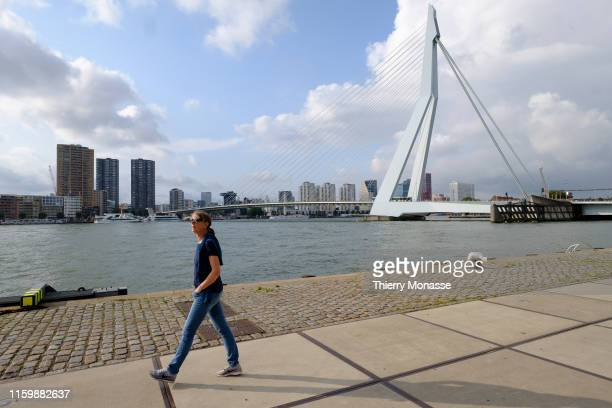 A man walks in front of the 'Erasmus Bridge' designed by Ben van Berkel is a combined cablestayed and bascule bridge over the Meuse river