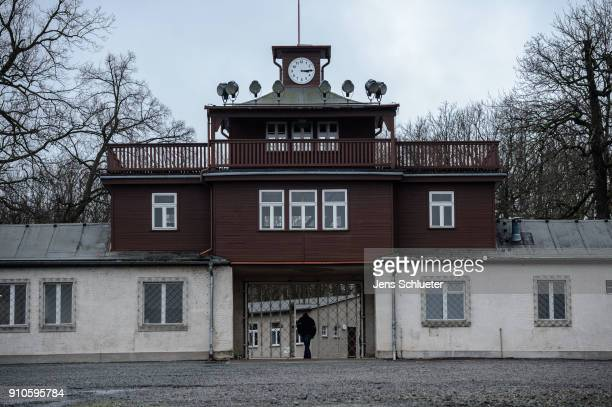 A man walks in front of the former main entrance to the Buchenwald concentration camp on January 26 2018 near Weimar Germany International Holocaust...