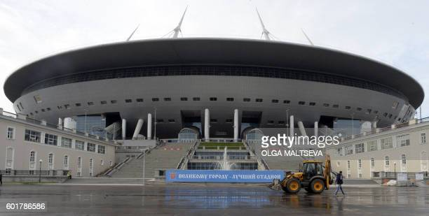 A man walks in front of the Krestovsky football stadium also known as Zenit Arena and currently under construction for the 2018 FIFA World Cup in...