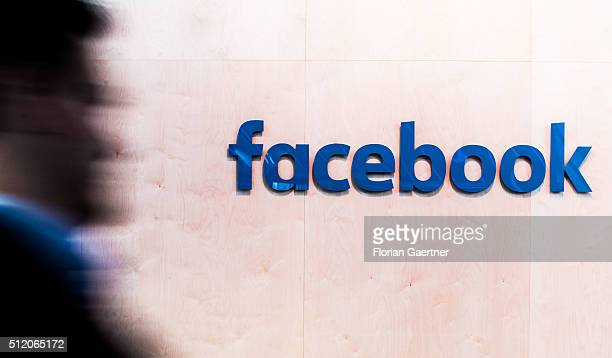 A man walks in front of the lettering of Facebook on February 24 2016 in Berlin Germany Facebook presented its Innovation Hub where new technology...