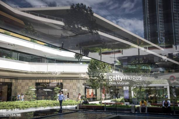A man walks in front of the Louis Vuitton store in the Zorlu luxury shopping mall on August 15 2018 in Istanbul Turkey The Turkish Lira recovered to...