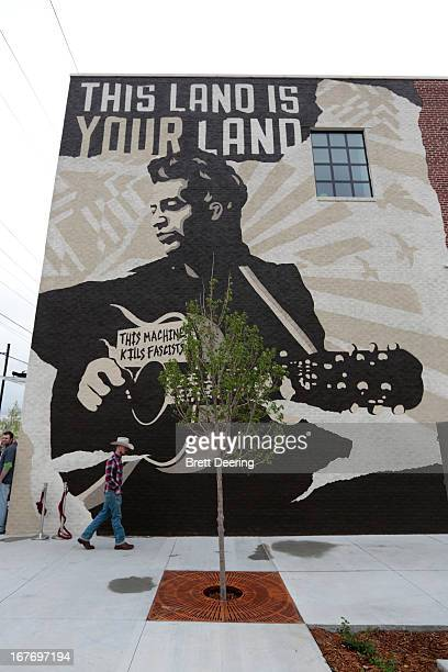 A man walks in front of the mural on the Woody Guthrie Center on April 27 2013 in Tulsa Oklahoma