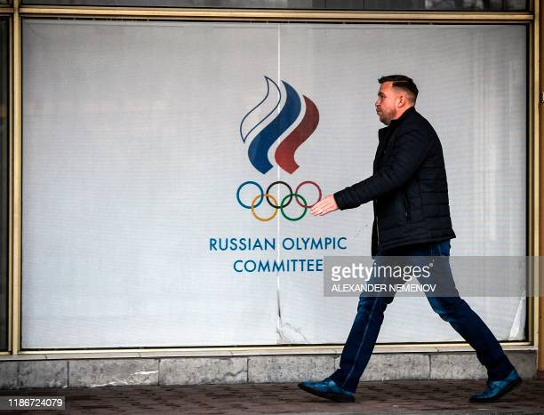 A man walks in front of the Russian Olympic Committee headquarters in Moscow on December 6 2019 The executive committee of the World AntiDoping...