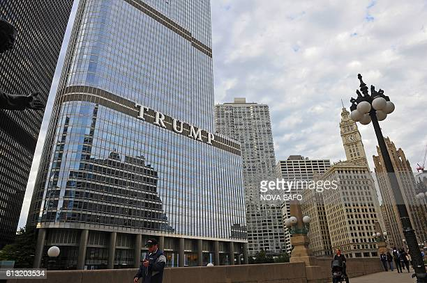 A man walks in front of the Trump Tower in Chicago Illinois on October 7 2016 Chicagoans are not too happy with Donald Trump's portrayal of their...