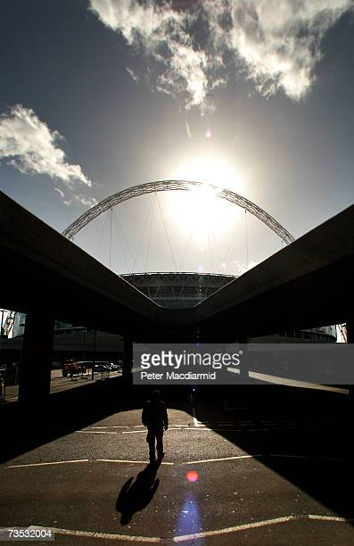 A man walks in front of Wembley Stadium on March 9 2007 in London The Football Association is expected to receive the keys to the GBP757 million...