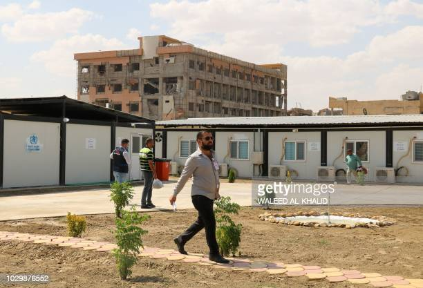 A man walks in the courtyard at the alJamhuri hospital complex in the northern city of Mosul on September 9 2018 Two hospitals reopened in western...