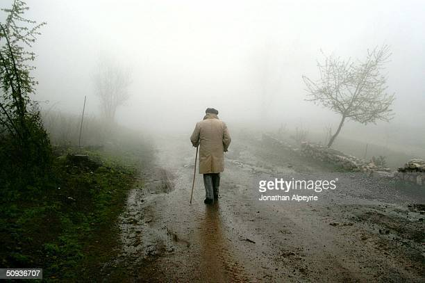 Man walks in the early morning fog in the town of Shushi April 26, 2004 in Nagorno-Karabakh, Azerbaijan. The town of Shushi was heavily destroyed...