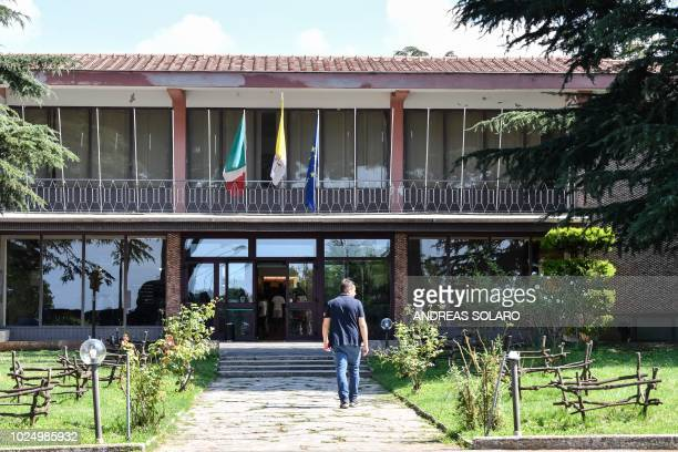 Man walks in the garden at the Catholic Church center 'Mondo Migliore' in Rocca di Papa, near Rome, on August 29, 2018. - Some 100 refugees and...