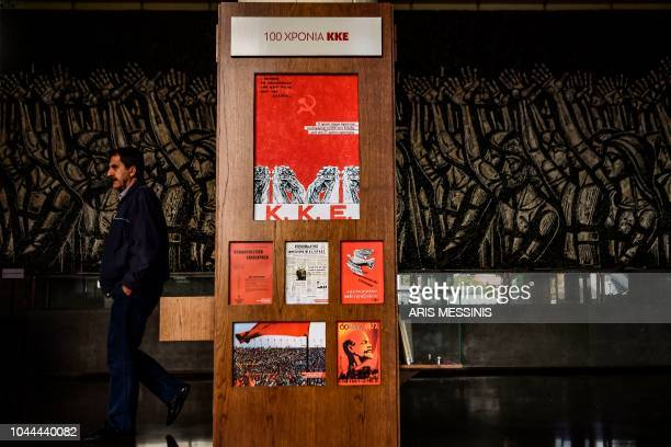 A man walks in the hall of the Greek Communist party compound in Athens on September 26 2018 The Greek Communist party KKE turns 100 next month a...
