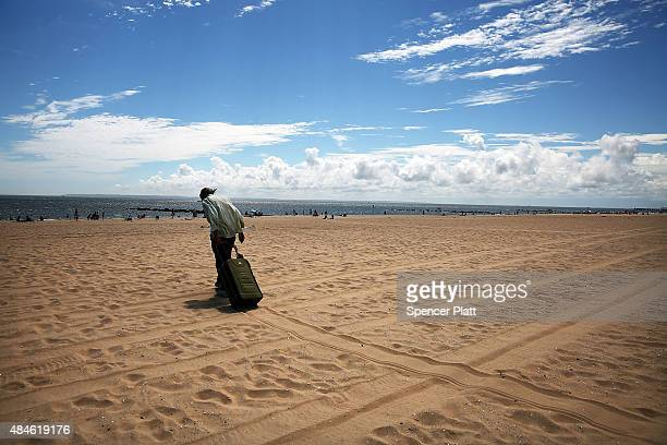 A man walks in the heat and sand at Brighton Beach in Brooklyn on August 20 2015 in New York City The National Oceanic and Atmospheric Administration...