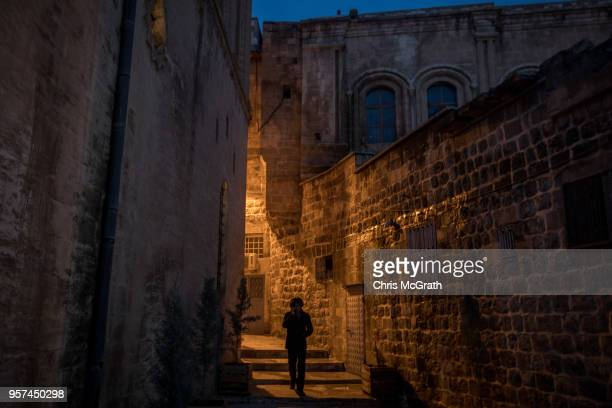 A man walks in the Old City of Mardin on May 11 2018 in Mardin Turkey Mardin a historical city in South Eastern Turkey is situated on top of a hill...