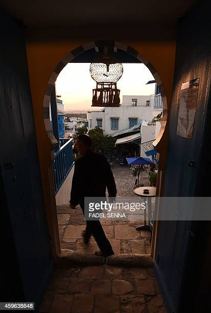 A man walks in the picturesque village of Sidi Bou Said 15 km from Tunis on October 26 2014 AFP PHOTO /FADEL SENNA