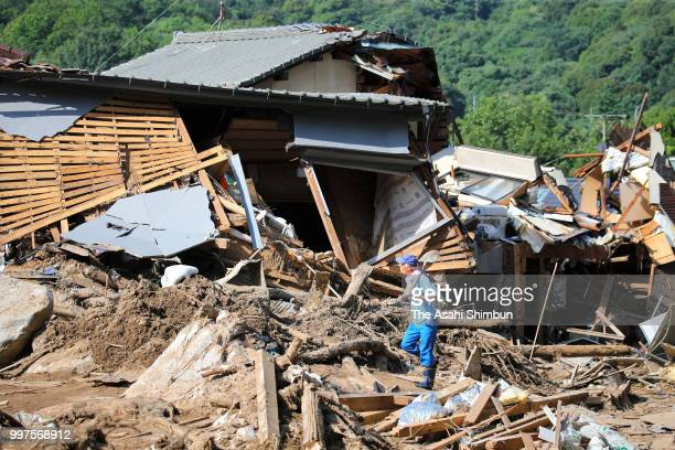 A man walks in the rubble on July 13 2018 in Hiroshima Japan The death toll from the torrential rain in western Japan due to landslides flooding and...