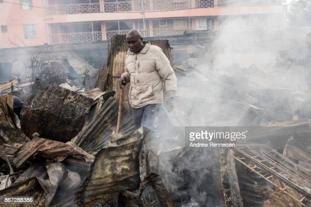 A man walks in the ruins of Kikuyu homes and shops which were destroyed in the Kawangware slum on October 28 2017 in Nairobi Kenya Protests turned...