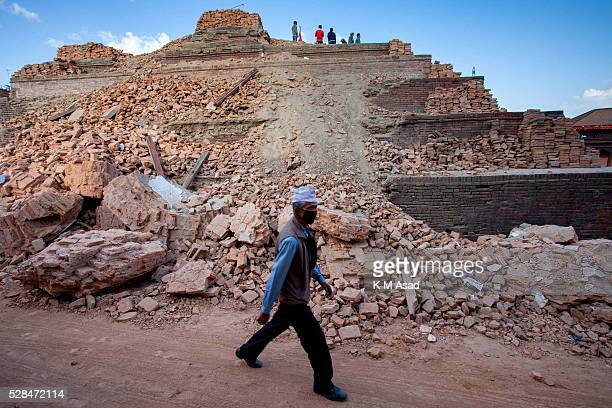 KATHMANDU BAKTOPUR KATHMANDU NEPAL A man walks in the site of a historic temple after a massive earthquake magnitude78 hit the country on 25 April...