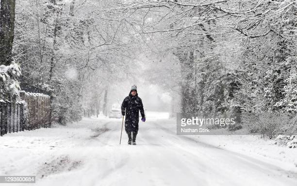 Man walks in the snow on December 29, 2020 in Newcastle-Under-Lyme, England. Heavy snow fall has covered the West Midlands as the Met Office has...