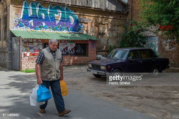 Man walks in the street in the Russian city of Voronezh on June 11 three days ahead of the Russia 2018 World Cup football tournament.