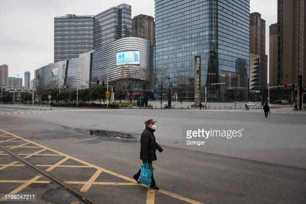 Man walks in the street on February 7, 2020 in Wuhan, Hubei province, China. The number of those who have died from the Wuhan coronavirus, known as...