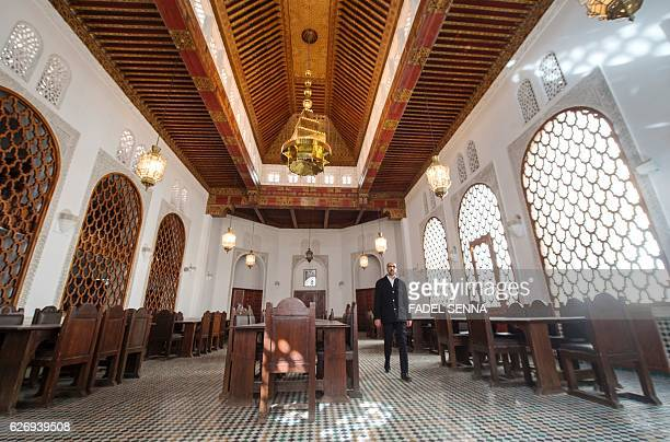 A man walks inside a hall at the alQarawyin Library in the Moroccan city of Fez on November 21 2016 Nestled in a labyrinth of streets in the heart of...