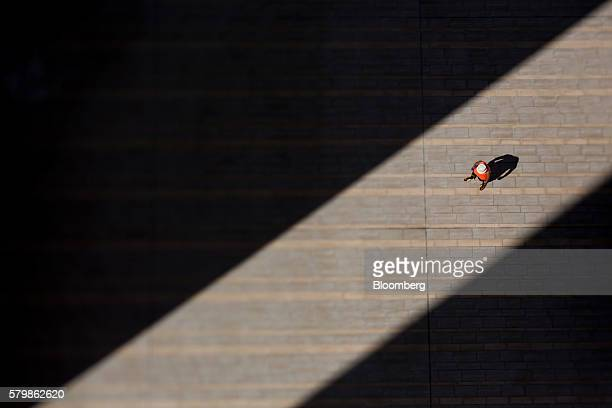 A man walks inside a residential building complex in Hong Kong China on Thursday July 21 2016 Hong Kong's trade balance figures are scheduled to be...