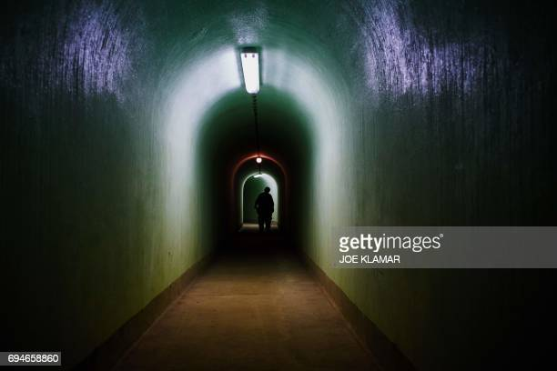 A man walks inside of the Skrilje bunker located in a forest 90 meters bellow the ground on a sealedoff military base near town of Kocevje Slovenia...