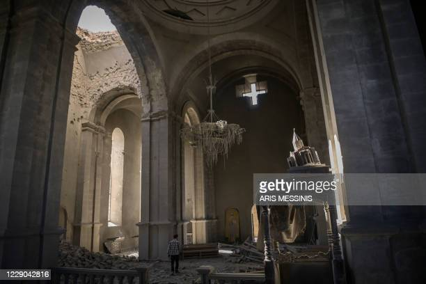 Man walks inside the damaged Ghazanchetsots Cathedral in the historic city of Shusha, some 15 kilometers from the disputed Nagorno-Karabakh...
