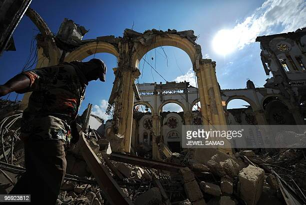 A man walks inside the destroyed PortauPrince cathedral in PortauPrince on January 21 2010 following the massive 70magnitude quake that shattered the...