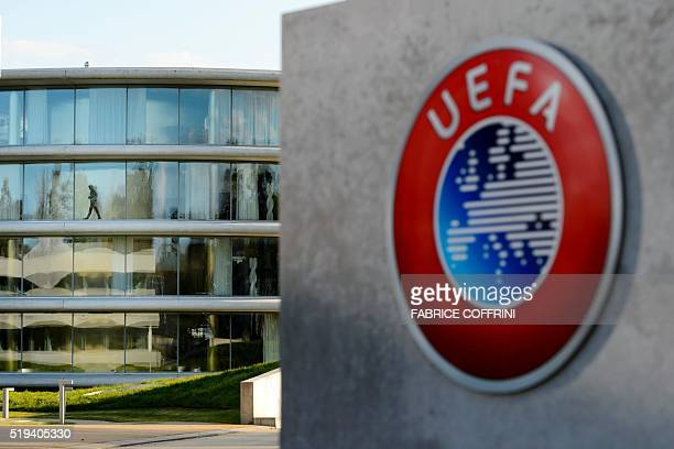 A man walks inside the headquarters of European football body UEFA in Nyon on April 6 2016 Swiss police raided the headquarters of European football...