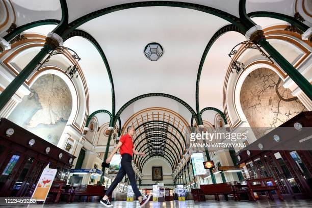 Man walks inside the late 19th century Saigon Central Post Office in Ho Chi Minh City on June 29, 2020.