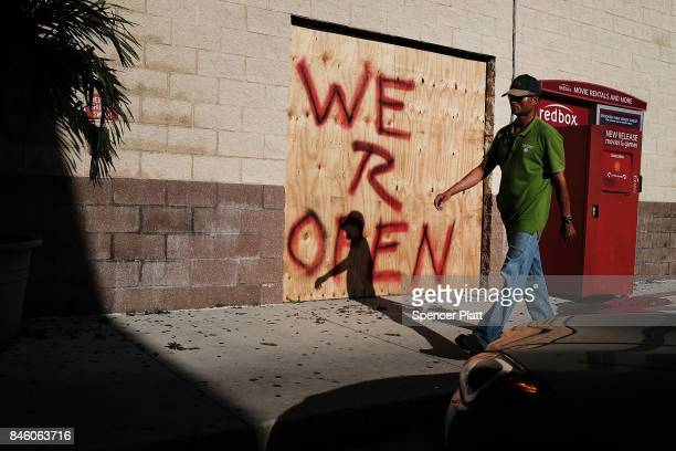 A man walks into a 7Eleven one of the few stores open two days after Hurricane Irma swept through the area on September 12 2017 in Cape Coral Florida...