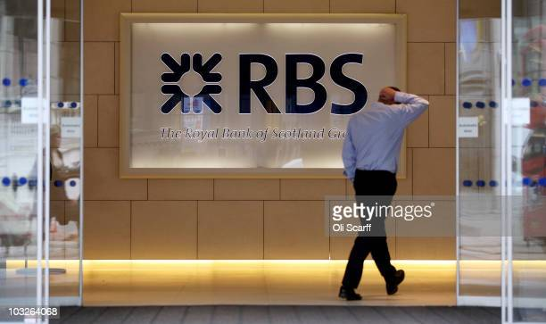 A man walks into a branch of The Royal Bank of Scotland in the City of London on August 6 2010 in London England RBS which is 84% owned by the...