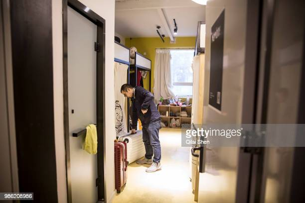 A man walks into his shared room inside a You community in Beijing China on Monday Nov 30 2015 Nearly 5000 people across China have moved into...