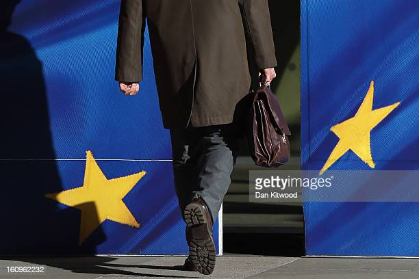 A man walks into the European Union Commission headquarters on February 8 2013 in Brussels Belgium EU leaders have set out the framework for agreeing...
