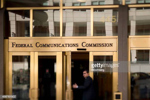 A man walks into the Federal Communications Commission headquarters in this photo taken with a tiltshift lens in Washington DC US on Monday Nov 10...