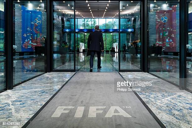 A man walks into the lobby at the FIFA headquarters during the FIFA Council Meeting on October 13 2016 in Zurich Switzerland