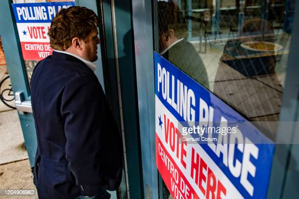 A man walks into the polling location at Taylor Elementary School to cast his ballot in the Democratic presidential primary elections on Super...